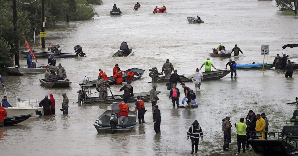 Rescue boats fill Tidwell Rd. as they help flood victims evacuate as floodwaters from Tropical Storm Harvey rise Monday, Aug. 28, 2017, in Houston. (AP Photo/David J. Phillip)